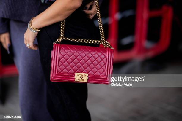 A guest wearing red Chanel bag is seen outside Natasha Zinko during London Fashion Week September 2018 on September 18 2018 in London England