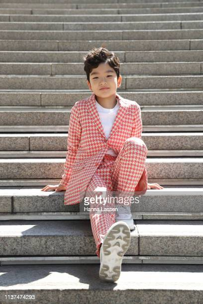 Guest wearing red check suit and white sneakers is seen at the Hera Seoul Fashion Week 2019 F/W at Dongdaemun Design Plaza at Dongdaemun Design Plaza...