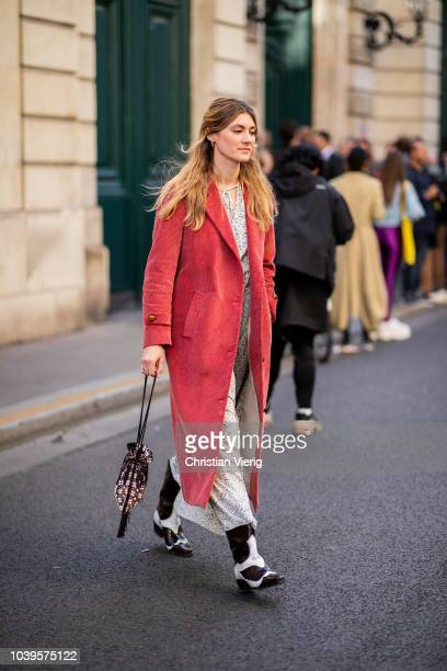 A guest wearing red coat is seen outside Jacquemus during Paris Fashion Week Womenswear Spring/Summer 2019 on September 24 2018 in Paris France