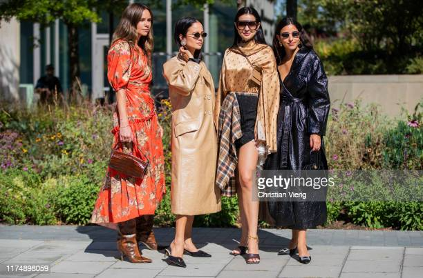 A guest wearing red dress with floral print Anna Rosa Vitiello wearing golden coat Doina Ciobanu wearing checkered skirt golden blouse and Bettina...