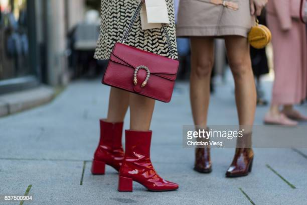 A guest wearing red Gucci bag and red boots outside byTiMo on August 22 2017 in Oslo Norway