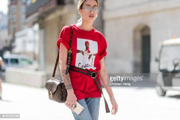 A guest wearing red Gucci tshirt belt Louis Vuitton bag cropped denim jeans outside Viktor Rolf during Paris Fashion Week Haute Couture Fall/Winter...
