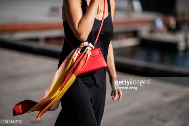 A guest wearing red Hermes bag with scarf is seen outside Munthe during the Copenhagen Fashion Week Spring/Summer 2019 on August 9 2018 in Copenhagen...