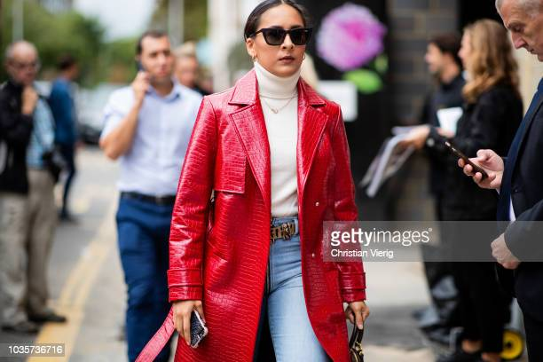 A guest wearing red leather coat is seen outside Natasha Zinko during London Fashion Week September 2018 on September 18 2018 in London England