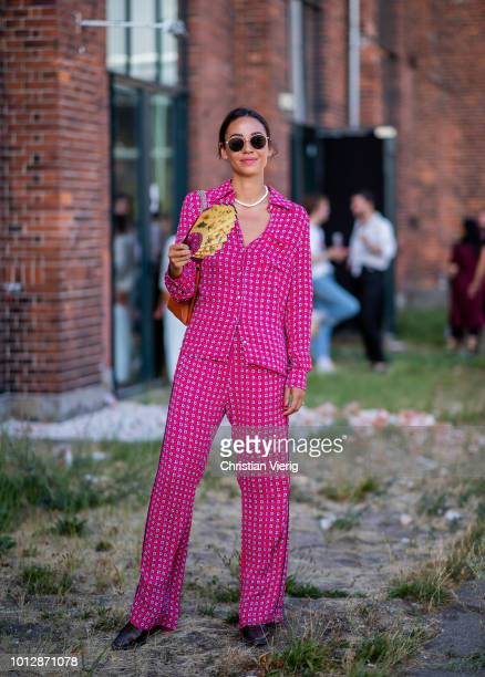 A guest wearing red pink suit Chloe bag is seen outside Designers Nest during the Copenhagen Fashion Week Spring/Summer 2019 on August 7 2018 in...