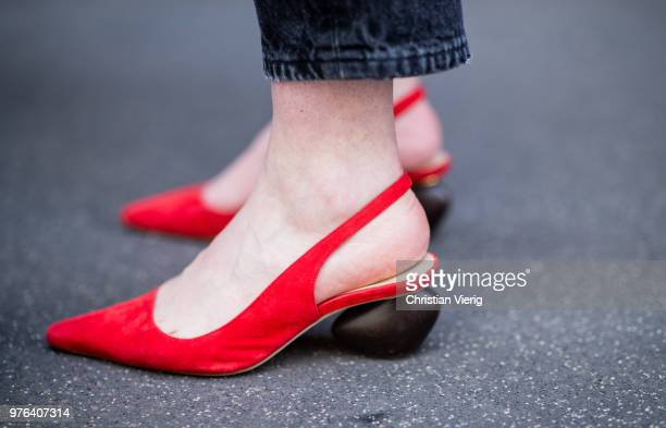 A guest wearing red pointed flats is seen outside Marni during Milan Men's Fashion Week Spring/Summer 2019 on June 16 2018 in Milan Italy