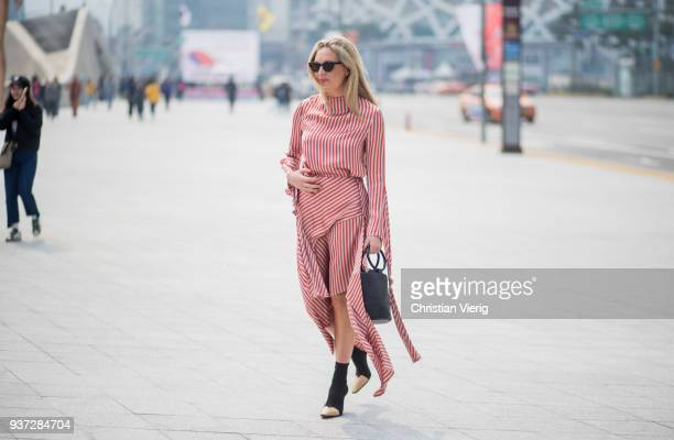 A guest wearing red white striped dress is seen at the Hera Seoul Fashion Week 2018 F/W at Dongdaemun Design Plaza on March 24 2018 in Seoul South...