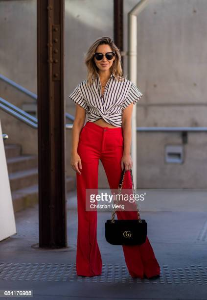 A guest wearing red wide leg pants striped top Gucci bag at day 4 during MercedesBenz Fashion Week Resort 18 Collections at Carriageworks on May 17...