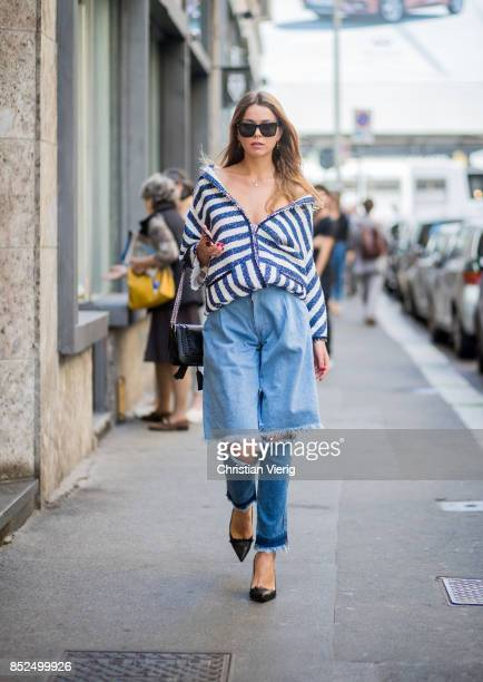 A guest wearing ripped denim jeans is seen outside Blumarine during Milan Fashion Week Spring/Summer 2018 on September 23 2017 in Milan Italy