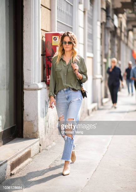 A guest wearing ripped jeans is seen outside Jil Sander during Milan Fashion Week Spring/Summer 2019 on September 19 2018 in Milan Italy