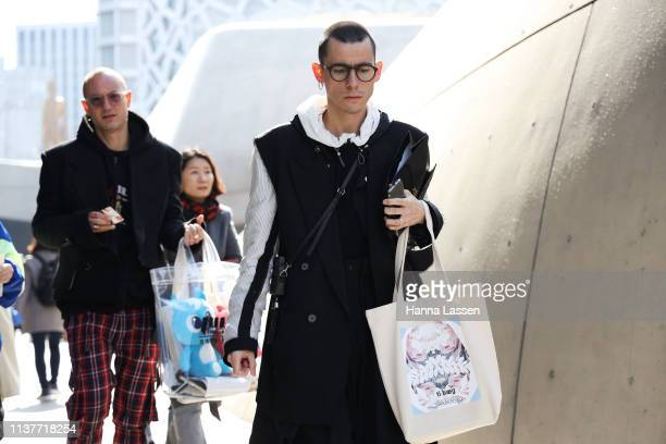 Guest wearing round glasses black vest coat and white hoodie is seen at the Hera Seoul Fashion Week 2019 F/W at Dongdaemun Design Plaza at Dongdaemun...