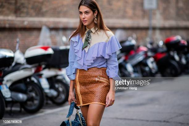 A guest wearing ruffled blouse zipped mini skirt is seen outside Max Mara during Milan Fashion Week Spring/Summer 2019 on September 20 2018 in Milan...