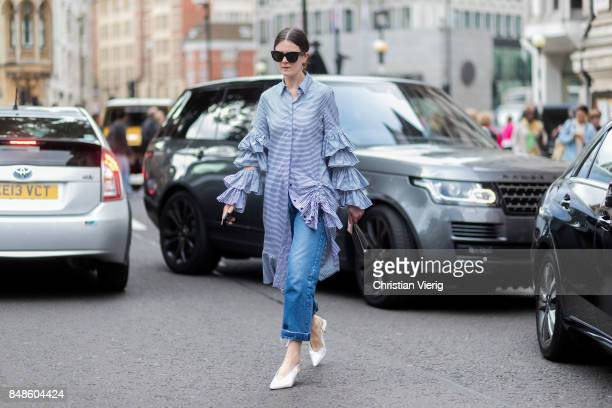 A guest wearing ruffled button shirt outside Preen during London Fashion Week September 2017 on September 17 2017 in London England