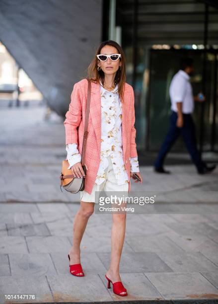 Guest wearing salmon colored blazer jacket is seen outside Designers Remix during the Copenhagen Fashion Week Spring/Summer 2019 on August 9, 2018 in...