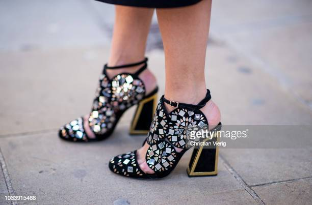 A guest wearing sandals is seen outside Anya Hindmarch during London Fashion Week September 2018 on September 15 2018 in London England