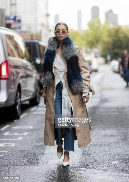 A guest wearing scarf trench coat cropped pants outside Molly Goddard during London Fashion Week September 2017 on September 16 2017 in London England