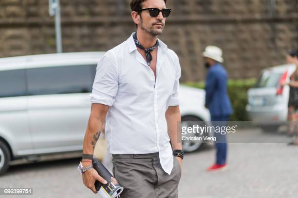 A guest wearing scarf white button shirt is seen during Pitti Immagine Uomo 92 at Fortezza Da Basso on June 15 2017 in Florence Italy
