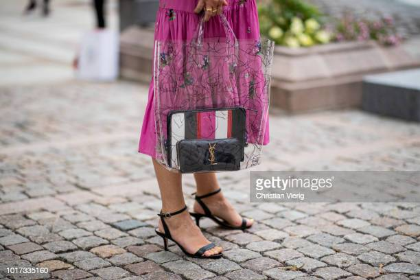 A guest wearing see through bag is seen outside Moire during Oslo Runway SS19 on August 15 2018 in Oslo Norway