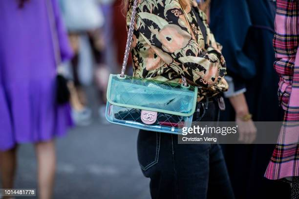 A guest wearing see through Chanel bag is seen outside Saks Potts during the Copenhagen Fashion Week Spring/Summer 2019 on August 9 2018 in...