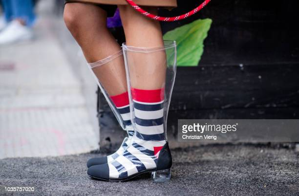 A guest wearing see through Chanel boots striped socks is seen outside Natasha Zinko during London Fashion Week September 2018 on September 18 2018...