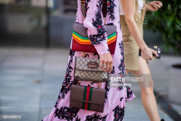A guest wearing several multi Gucci bags is seen outside Designers Remix during the Copenhagen Fashion Week Spring/Summer 2019 on August 9 2018 in...