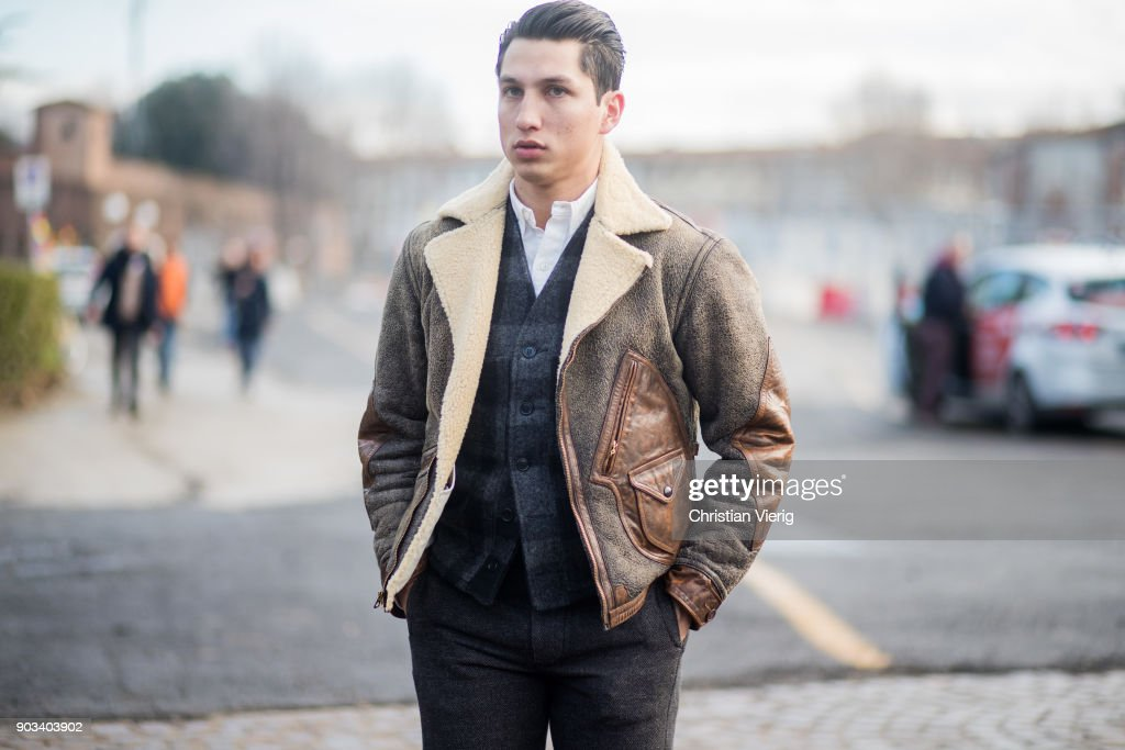 A guest wearing shearling jacket is seen during the 93. Pitti Immagine Uomo at Fortezza Da Basso on January 10, 2018 in Florence, Italy.