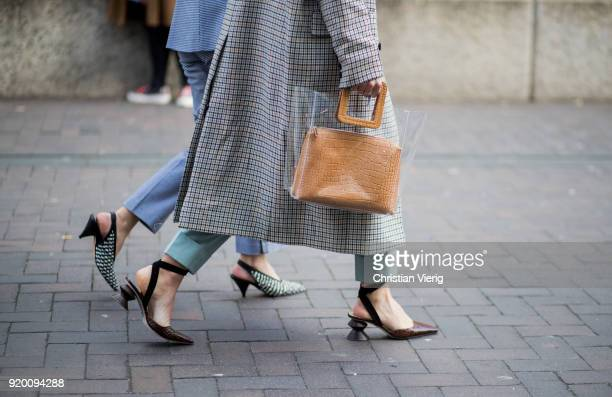 A guest wearing sheer bag seen outside Roland Mouret during London Fashion Week February 2018 on February 18 2018 in London England