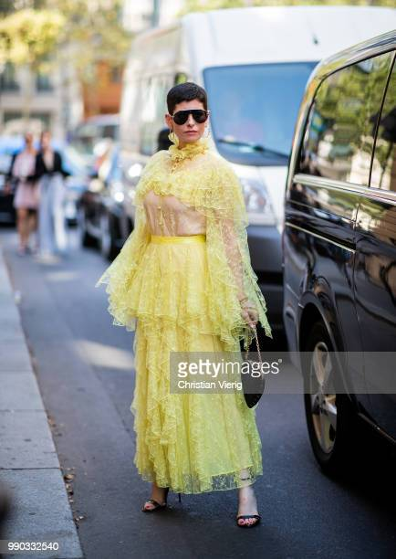 A guest wearing sheer yellow blouse and skirt is seen outside Ralph Russo on day two during Paris Fashion Week Haute Couture FW18 on July 2 2018 in...