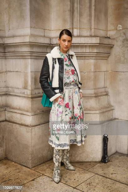 Guest wearing sherling jacket, snakeskin boots and floral two-piece outside Stella McCartney during Paris Fashion Week Womenswear Fall/Winter...