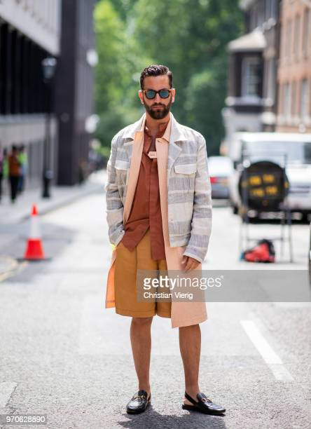 A guest wearing shorts is seen during London Fashion Week Men's June 2018 on June 9 2018 in London England