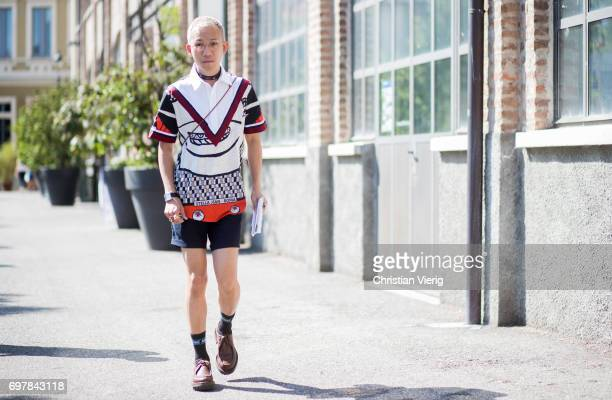 A guest wearing shorts socks is seen outside GCDS during Milan Men's Fashion Week Spring/Summer 2018 on June 19 2017 in Milan Italy