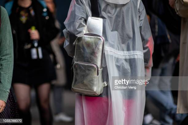 A guest wearing silver Alyx bag is seen outside Matty Bovan during London Fashion Week September 2018 on September 14 2018 in London England