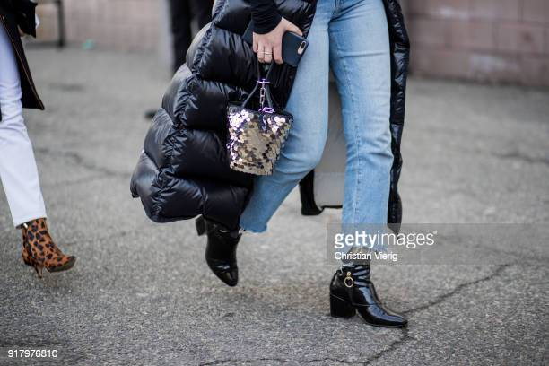 A guest wearing silver bag seen outside Coach on February 13 2018 in New York City