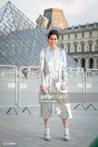 Guest wearing silver spangle dress, silver mary jane shoes and yellow clutch outside the Louis Vuitton show during Paris Fashion Week Womenswear...