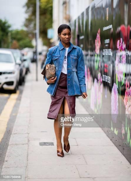 A guest wearing skirt with slit denim jacket Fendi bag is seen outside Natasha Zinko during London Fashion Week September 2018 on September 18 2018...