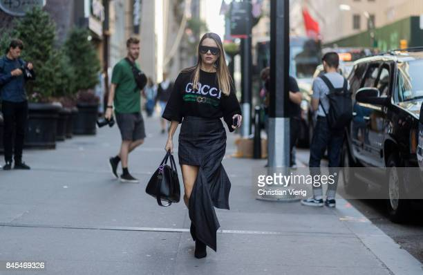 A guest wearing skirt with slit Gucci tshirt seen in the streets of Manhattan outside Victoria Beckham during New York Fashion Week on September 10...
