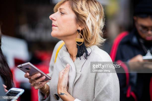 A guest wearing statement earrings is seen outside Natasha Zinko during London Fashion Week September 2018 on September 18 2018 in London England