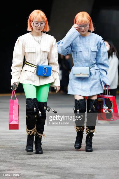 Guest wearing striped and check jacket Marc Jacobs waist belt bag and Moschino knee high boots is seen at the Hera Seoul Fashion Week 2019 F/W at...