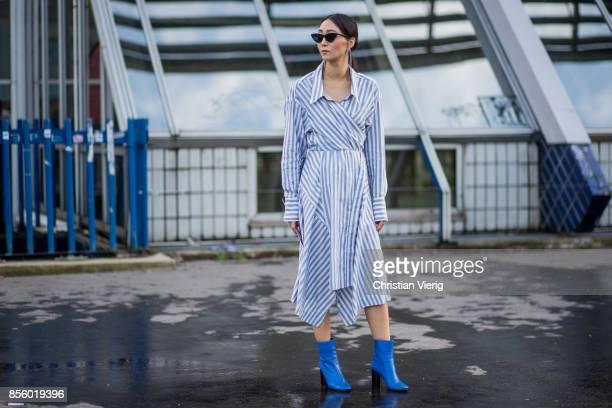 A guest wearing striped dress is seen outside Haider Ackermann during Paris Fashion Week Spring/Summer 2018 on September 30 2017 in Paris France