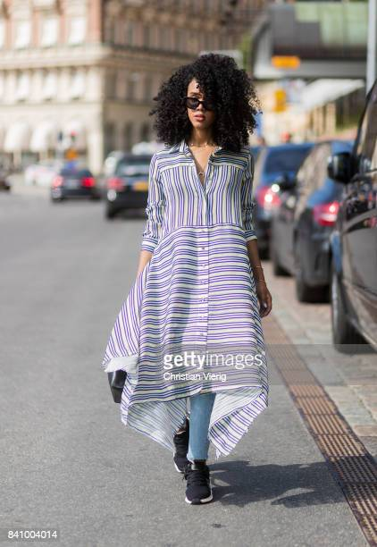 Guest wearing striped dress outside Whyred on August 30, 2017 in Stockholm, Sweden.