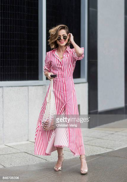 A guest wearing striped dress white bag seen in the streets of Manhattan outside Marchesa during New York Fashion Week on September 13 2017 in New...