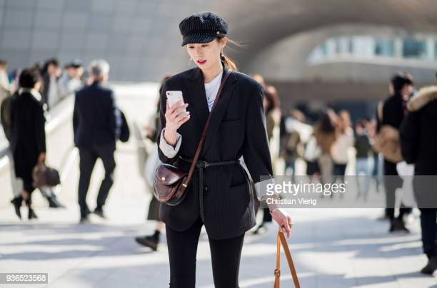 A guest wearing striped flat cap is seen at the Hera Seoul Fashion Week 2018 F/W at Dongdaemun Design Plaza on March 22 2018 in Seoul South Korea