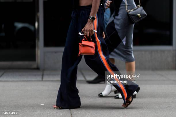 A guest wearing striped pants mini bag seen in the streets of Manhattan outside Dion Lee during New York Fashion Week on September 9 2017 in New York...