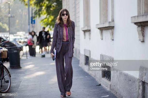 A guest wearing striped suit is seen outside Tods during Milan Fashion Week Spring/Summer 2018 on September 22 2017 in Milan Italy
