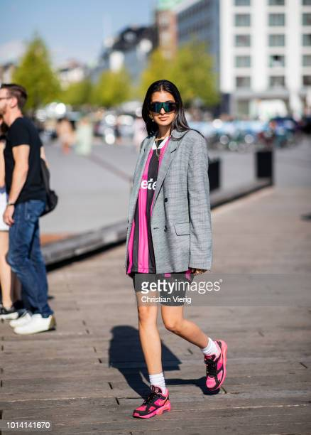 A guest wearing striped tshirt cycle pants grey blazer jacket is seen outside Munthe during the Copenhagen Fashion Week Spring/Summer 2019 on August...