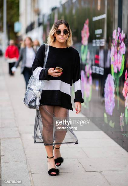 A guest wearing sweater sheer skirt sandals is seen outside Natasha Zinko during London Fashion Week September 2018 on September 18 2018 in London...