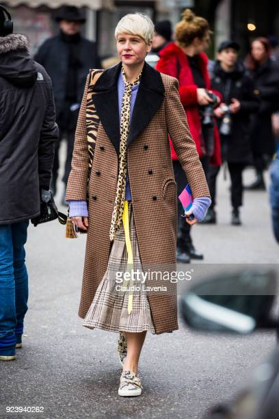 Guest wearing tartan coat and Bally shoes is seen outside Giorgio Armani show during Milan Fashion Week Fall/Winter 2018/19 on February 24 2018 in...