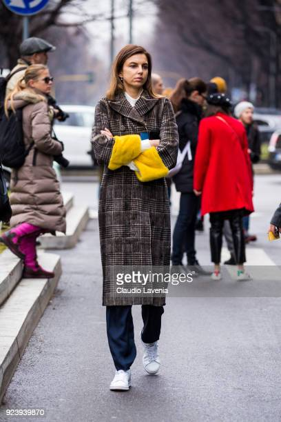 Guest wearing tartan coat is seen outside Giorgio Armani show during Milan Fashion Week Fall/Winter 2018/19 on February 24 2018 in Milan Italy