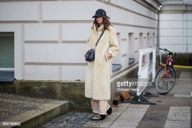 A guest wearing teddy coat cap is seen outside Der Berliner Modesalon during the Berlin Fashion Week January 2018 on January 16 2018 in Berlin Germany