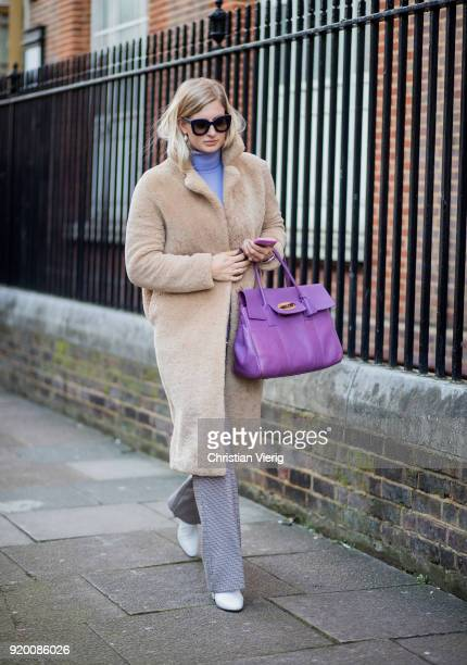 A guest wearing teddy coat purple Mulberry bag seen outside Temperley London during London Fashion Week February 2018 on February 18 2018 in London...